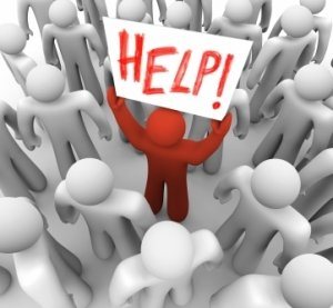 stockfresh_327459_person-holding-help-sign-in-crowd_sizeXS